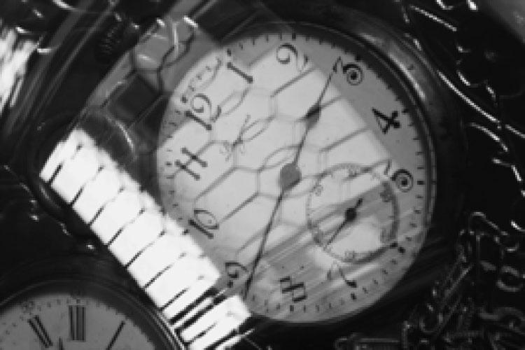 Dettaglio della locandina: immagine di un orologio