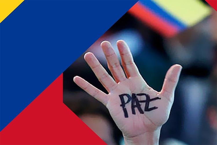 """Dettaglio della locandina: mano con su scritto """"paz"""""""